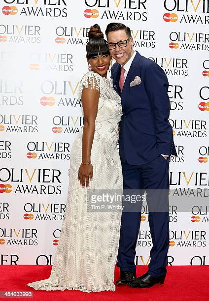 Alexandra Burke and Gok Wan poses in the press room at the Laurence Olivier Awards at The Royal Opera House on April 13 2014 in London England