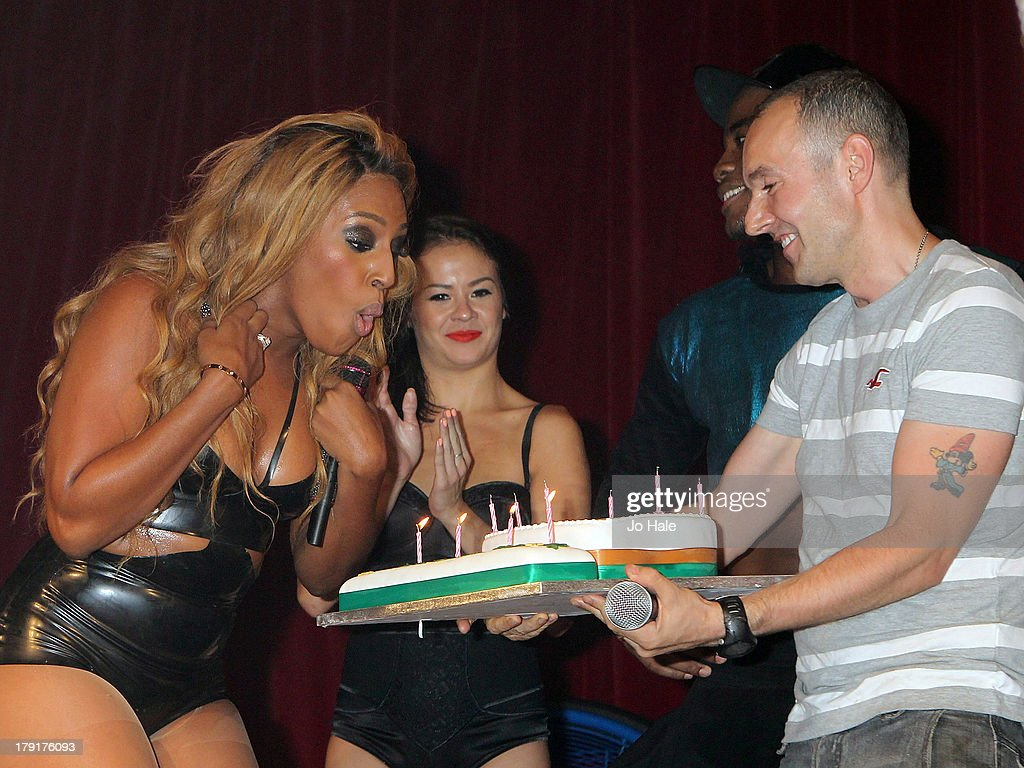 <a gi-track='captionPersonalityLinkClicked' href=/galleries/search?phrase=Alexandra+Burke&family=editorial&specificpeople=5592177 ng-click='$event.stopPropagation()'>Alexandra Burke</a> blows out the candles on her Birthday Cake presented by Jeremy Joseph after her performance on stage at G-A-Y on August 31, 2013 in London, England.