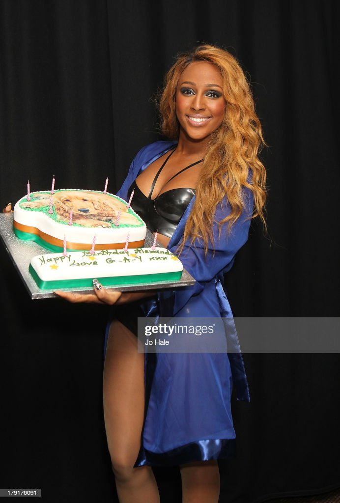 <a gi-track='captionPersonalityLinkClicked' href=/galleries/search?phrase=Alexandra+Burke&family=editorial&specificpeople=5592177 ng-click='$event.stopPropagation()'>Alexandra Burke</a> poses backstage with her Birthday Cake at G-A-Y on August 31, 2013 in London, England.