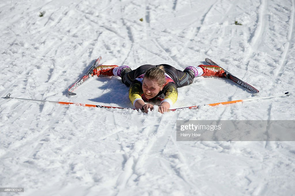 Alexandra Camenscic of the Republic of Moldova collapses at the finish line in the Women's 10 km Classic during day six of the Sochi 2014 Winter Olympics at Laura Cross-country Ski & Biathlon Center on February 13, 2014 in Sochi, Russia.