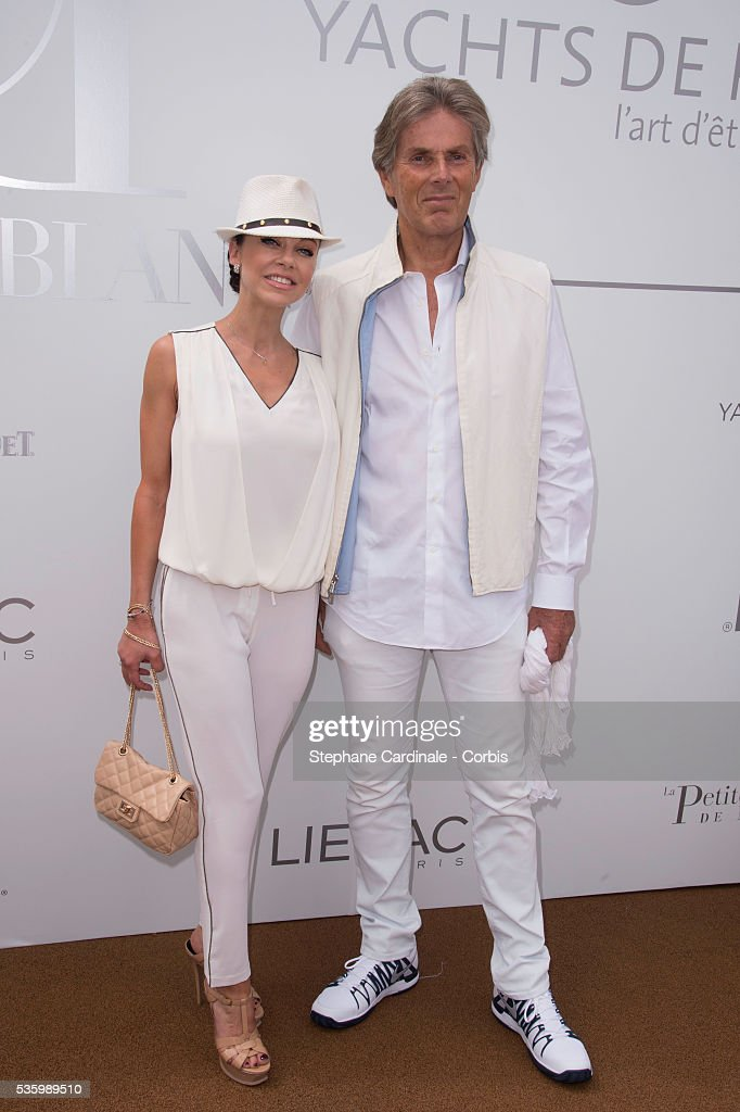 Alexandra Cardinale and Dominique Desseigne attend the 'Brunch Blanc' hosted by Barriere Group. Held on Yacht 'Excellence' on June 29, 2014 in Paris, France.