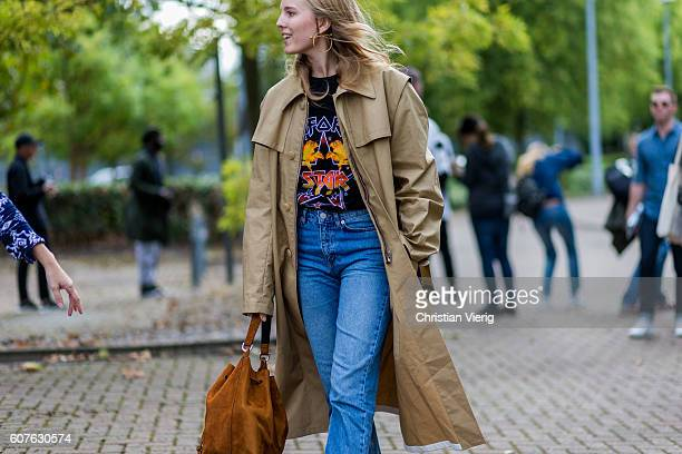 Alexandra Carl wearing a trench coat Star Wars tshirt and denim jeans outside Mulberry during London Fashion Week Spring/Summer collections 2017 on...