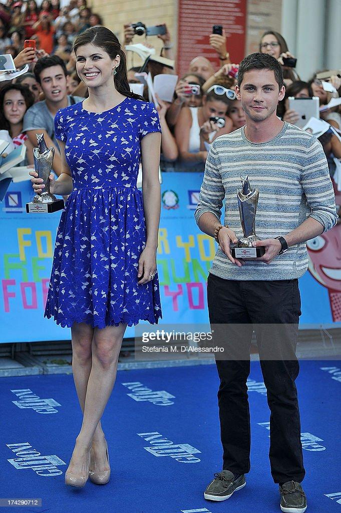 Alexandra Daddario and Logan Lerman attend 2013 Giffoni Film Festival blue carpet on July 23, 2013 in Giffoni Valle Piana, Italy.
