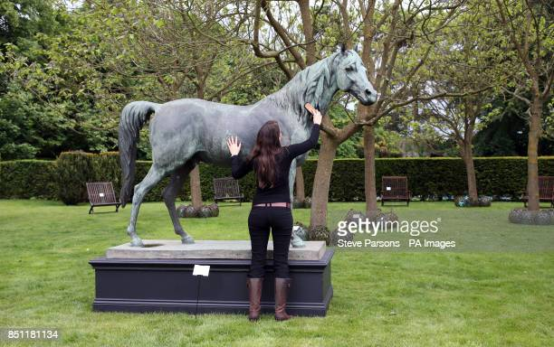 Alexandra Deyzac from Chrisite's checks a French Bronze life size model of a stallion est 100000200000 which is part of Dunsborough Park Garden...