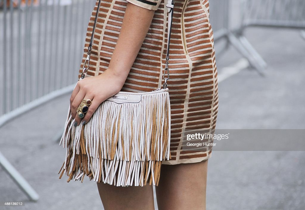 Alexandra Dieck is seen on the streets of Manhattan outside of the Lie Sangbong Spring 2016 fashion show at Skylight at Moynihan Station wearing Ikai dress and Rebecca Minkoff fringe cream and tan leather bag on September 13, 2015 in New York City.