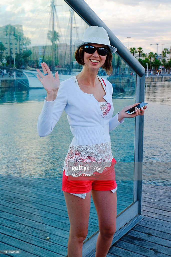 Alexandra from Czech Republic seen wearing a hat from a flea market, shirtwaist and pants form H&M, and Rieker shoes on June 25, 2014 in Barcelona, Spain.