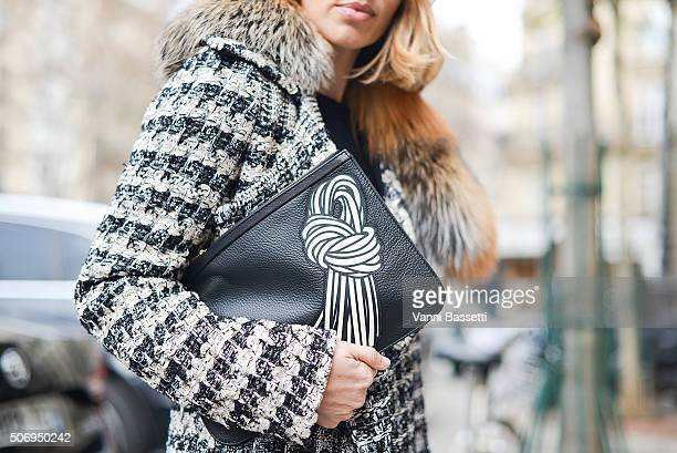 Alexandra Golovanoff poses wearing a Bouchra Jarrar coat and Pierre Hardy bag before Bouchra Jarrar show during Haute Couture on January 26 2016 in...