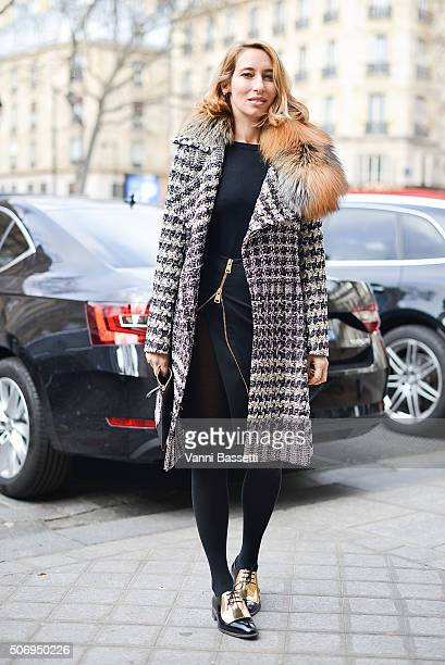 Alexandra Golovanoff poses wearing a Bouchra Jarrar coat Pierre Hardy bag and Celine shoes before Bouchra Jarrar show during Haute Couture on January...