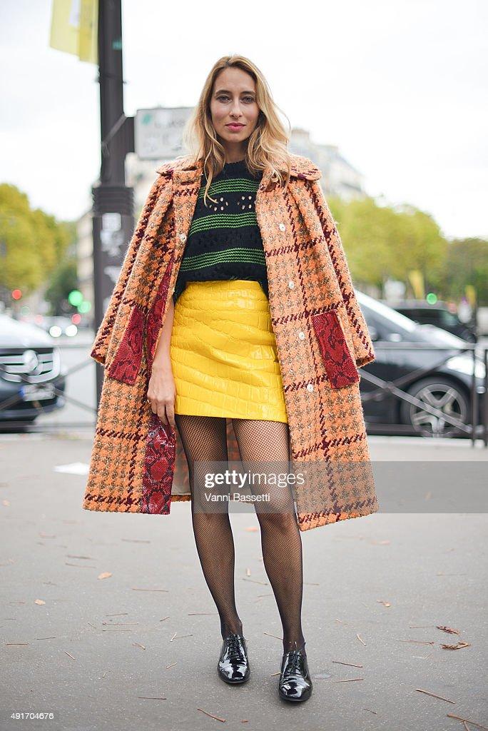 Alexandra Golovanoff poses wearing Miu Miu after the Miu Miu show at the Palais de Iena during Paris Fashion Week SS16 on October 7 2015 in Paris...
