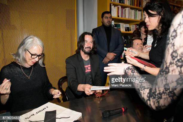 Alexandra Grant actor Keanu Reeves and Benoit Fougeirol attend the 'X Artists' books launch at Palais De Tokyo on November 10 2017 in Paris France
