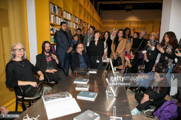 Alexandra Grant actor Keanu Reeves and Staffan Ahrenberg attend the 'X Artists' books launch at Palais De Tokyo on November 10 2017 in Paris France