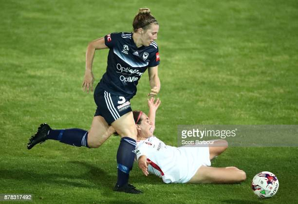 Alexandra Gummer of the Victory and Rosie Dee Sutton of the Wanderers compete for the ball during the round eight WLeague match between the Melbourne...