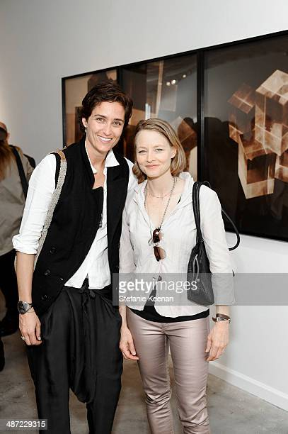 Alexandra Hedison and Jodie Foster attend Firooz Zahedi Opening At Kopeikin Gallery on April 27 2014 in Los Angeles California