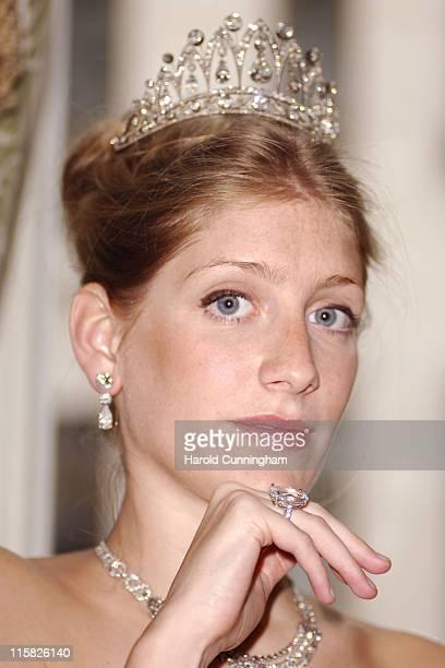 Alexandra Jaffray wearing an antique diamond tiara with a row of brochettecut diamonds centre pear shaped diamond of approximately 8 carrats circa...