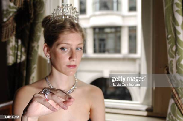 Alexandra Jaffray wearing an antique diamond tiara with a row of brochettecut diamonds centre pear shaped diamond of approximately 8 carrats circa...