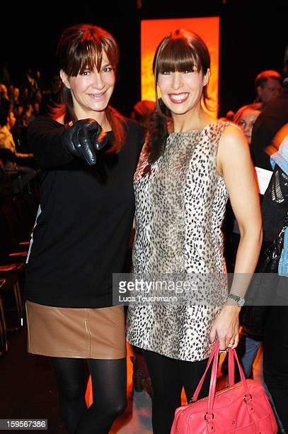 Alexandra Kamp and Alexandra Polzin attend Minx By Eva Lutz Autumn/Winter 2013/14 fashion show during MercedesBenz Fashion Week Berlin at Brandenburg...