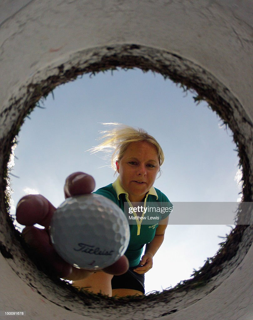 Alexandra Keighley of Huddersfield Golf Club retrieves her ball the Glenmuir WPGA Professional Championship at Carden Park Golf Club on August 10, 2012 in Chester, England.