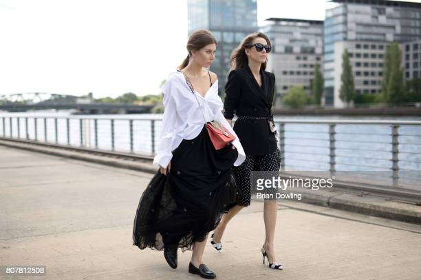 Alexandra Lapp and Vicky Heiler pose at the Marc Cain street style shooting during MercedesBenz Fashion Week Berlin Spring/Summer 2018 on July 4 2017...