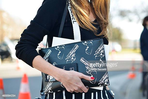 Alexandra Lapp poses wearing Emilio Pucci pants St Laurent clutch and Chanel suspenders on Day 6 of Paris Fashion Week Womenswear FW15 on March 8...