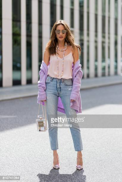 Alexandra Lapp wearing a purple cashmere cardigan by Heartbreaker a rose tank top in silk from Jadicted a high waist nonstrech denim fivepocket 501...