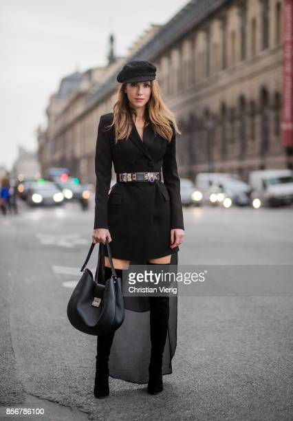 Alexandra Lapp wearing a Tuxedo Dress with detachable overlay in black from Pearl and Rubies collier de chien waist belt by Hermes black overknee...