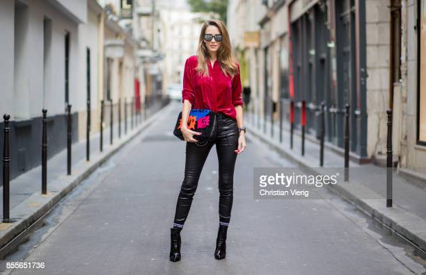 Alexandra Lapp wearing a velvet blazer from Jadicted in burgundy red leather pants in black with laced high waist and ankle zippers from Unravel...