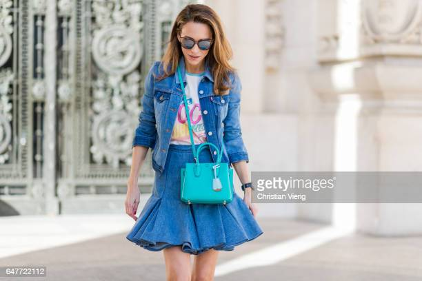 Alexandra Lapp wearing Aline denim skirt from Balmain denim Jackit Levis colorful graphic TShirt Chanel from Chanel Cuba Cruise 2017 collection Pumps...
