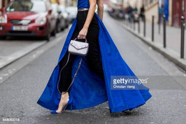 Alexandra Lapp wearing Blue taffeta and leather top from Pearl and Rubies with a skin barring asymmetric oneshoulder Silhouette Black pants from...