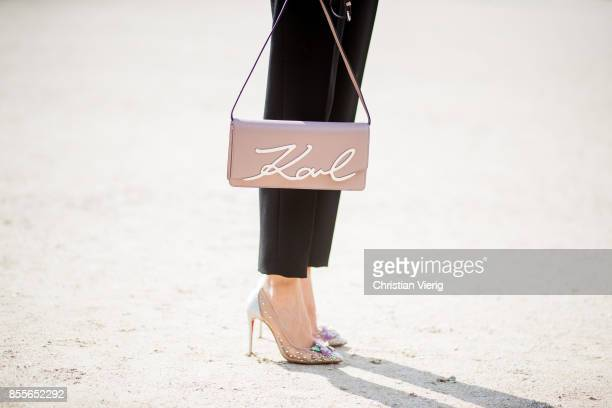 Alexandra Lapp wearing high waist pants in black from Zara cashmere turtleneck in light pink from Jil Sander light pink calf leather logo plaque...