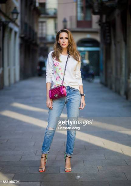 Alexandra Lapp wearing offwhite round neck cashmere pullover with flower applications in pastel tones vintage Leviss from Re Done Sophia Webster...