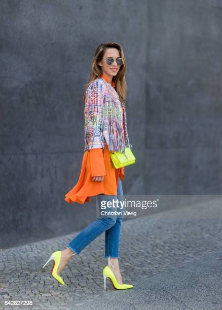 Alexandra Lapp wearing orange long silk blouse from Alexander McQueen colorful tweed jacket with fringes from Thomas Rath yellow neon pumps from...