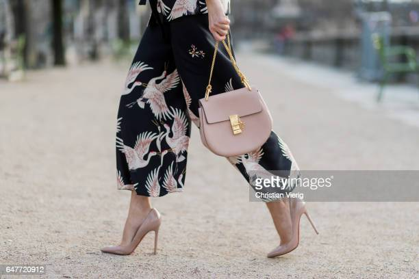 Alexandra Lapp wearing Printed jacket with contrasting sash belt lapel collar and long sleeves from Zara in black with rose birds Matching flowing...