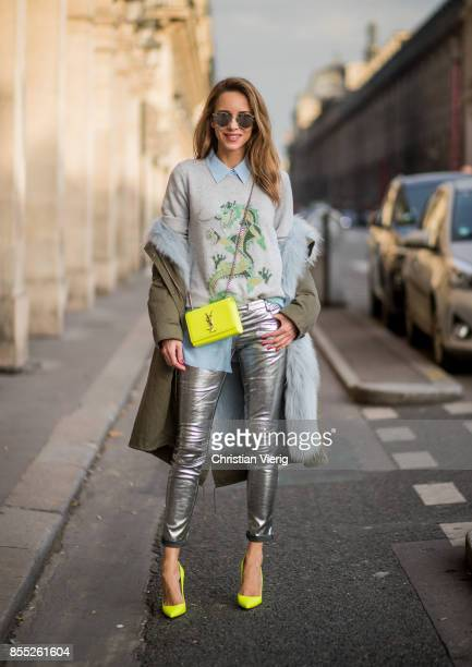 Alexandra Lapp wearing silver biker pants in leather by Balmain long blue silk blouse from Equipment cashmere pullover in grey with a green dragon...
