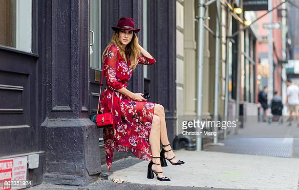 Alexandra Lapp wearing wearing a red Patrizia Pepe dress hat heels and bag outside on September 10 2016 in New York City