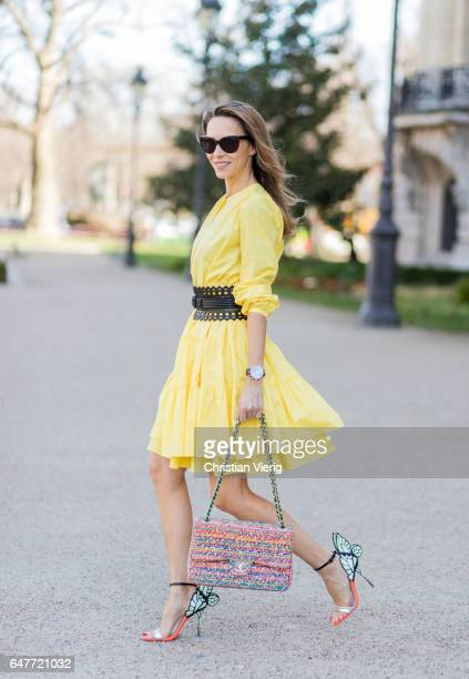 Alexandra Lapp wearing yellow banana dress Marc Cain loosefitting dress with flouncelike tiers narrow singlebuttoned Azzedine Alaia Chiara Butterfly...