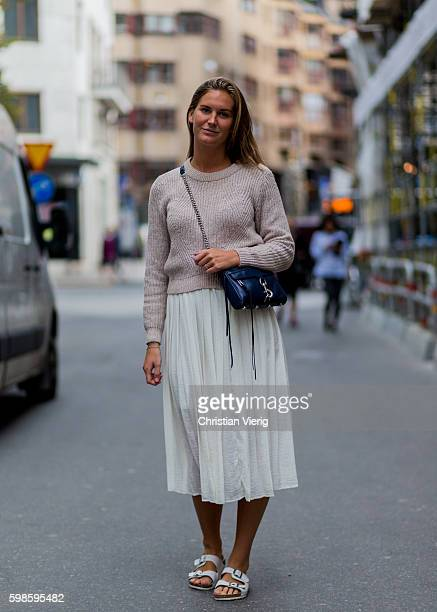 Alexandra Livijn wearing a jumper white maxi skirt and white Birkenstock sandals on September 1 2016 in Stockholm Sweden