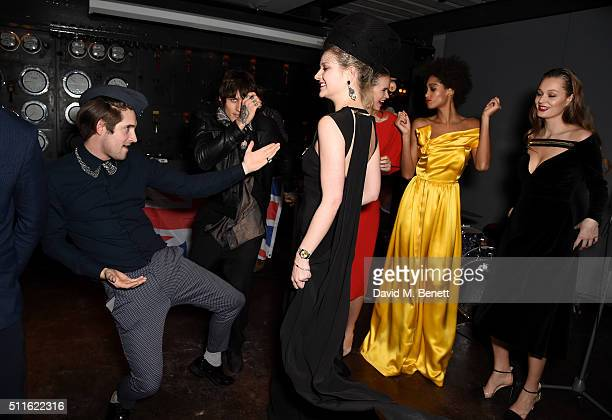 Alexandra Long dances with guests at her homage to the Great Women of Britain with the debut London Fashion Week Presentation Enigma II held at The...