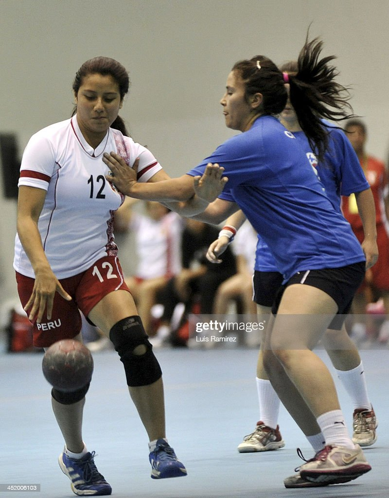 Alexandra Lopez of Peru vies for the ball with Carolina Verdejo of Chile during a match between Peru and Chile in Women's handball as part of the XVII Bolivarian Games Trujillo 2013 at Colegio San Agustin on November 25, 2013 in Chiclayo, Peru.