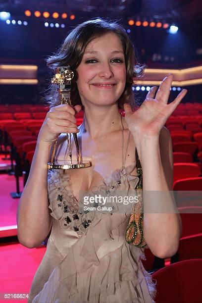 Alexandra Maria Lara holds her Goldene Kamera Award for Best Actress at the 'Goldene Kamera' Awards at the Axel Springer House on February 9 2005 in...