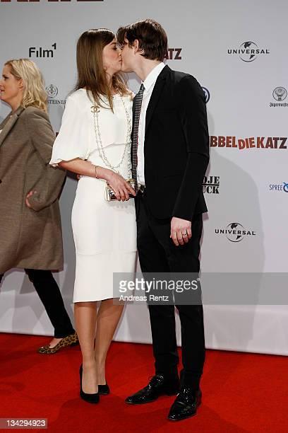 Alexandra Maria Lara kisses her husband Sam Riley at the 'RUBBELDIEKATZ' Premiere at Cinemaxx on November 30 2011 in Berlin Germany