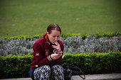Alexandra Moser from Austria poses for a photograph as she smokes a cigarette on October 15 in Parliament Square in London England Following a report...