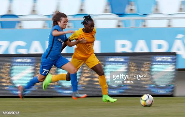 Alexandra Nagy of MTK Hungaria FC competes for the ball with Chinwendu Ihezuo of WFC BIIKKazygurt during the UEFA Women's Champions League Qualifying...