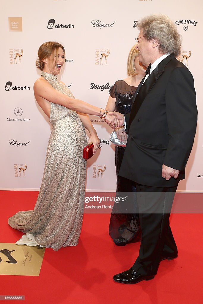 Alexandra Neldel greets Helmut Markwort and Patrizia Riekel during attends 'BAMBI Awards 2012' at the Stadthalle Duesseldorf on November 22, 2012 in Duesseldorf, Germany.