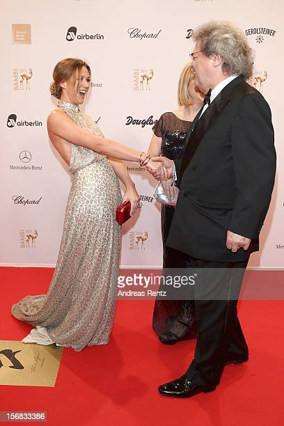 Alexandra Neldel greets Helmut Markwort and Patrizia Riekel during attends 'BAMBI Awards 2012' at the Stadthalle Duesseldorf on November 22 2012 in...