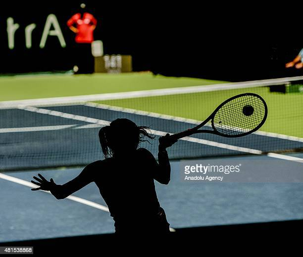 Alexandra Panova of Russia returns the ball to Roberta Vinci of Italy during the TEB BNP Paribas Istanbul Cup tennis tournament at Koza World of...