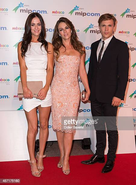 Alexandra Park Elisabeth Hurley and William Moseley attend the opening red carpet party MIPCOM 2014 at Hotel Martinez on October 13 2014 in Cannes...