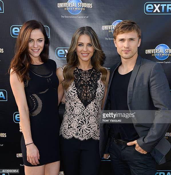 Alexandra Park Elizabeth Hurley and William Moseley visit 'Extra' at Universal Studios Hollywood on November 17 2016 in Universal City California