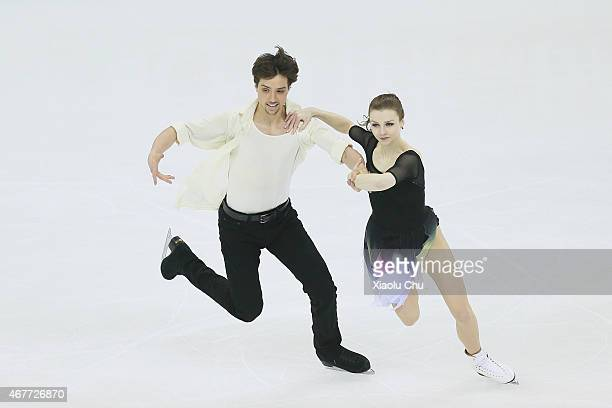 Alexandra Paul and Mitchell Islam of Canada perform during the Ice DanceFree Dance on day three of the 2015 ISU World Figure Skating Championships at...