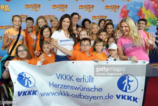 Alexandra Polzin Alessandra Geissel and children attend the Charity Premiere 'Madagascar 3' at the Circus Krone on September 16 2012 in Munich Germany