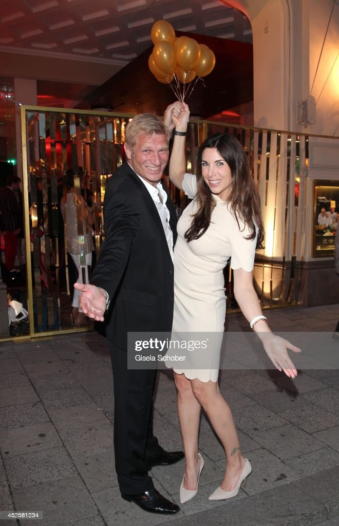 <a gi-track='captionPersonalityLinkClicked' href=/galleries/search?phrase=Alexandra+Polzin&family=editorial&specificpeople=221672 ng-click='$event.stopPropagation()'>Alexandra Polzin</a> (R) and her husband Gerhard Leinauer attend the Eclat Dore summer party at Hotel Vier Jahreszeiten Kempinski on July 23, 2014 in Munich, Germany.